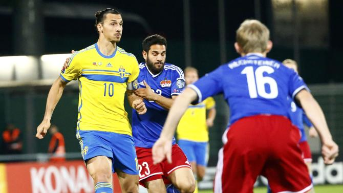 Sweden?s Ibrahimovic fights for the ball with Liechtenstein's Polverino during their soccer match in Vaduz