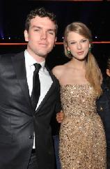 Taylor Swift and brother Austin Swift are seen at the 2011 American Music Awards held at Nokia Theatre L.A. LIVE in Los Angeles on November 20, 2011 -- WireImage