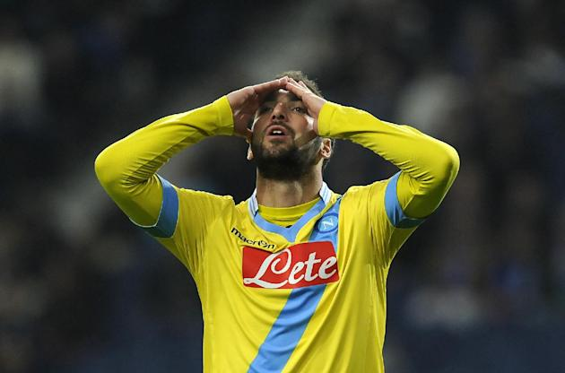 Napoli's Gonzalo Higuain, from Argentina, reacts after missing a shot against FC Porto during their Europa League round of 16, first leg soccer match at the Dragao stadium, in Porto, Portugal, Thu