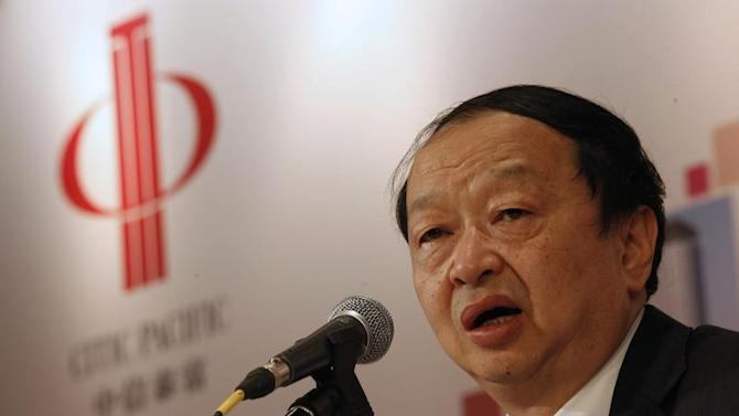 CITIC Pacific Chairman Chang speaks in front of the company's logo during a news conference in Hong Kong