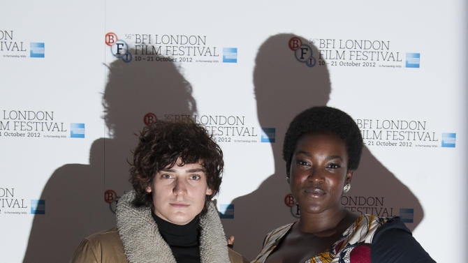 "Actors Aneurin Barnard and Wunmi Mosaku arrive during the BFI London Film Festival at the premiere of ""Citadel"" on Friday, Oct. 19, 2012, in London. (Photo by Ki Price/Invision/AP)"