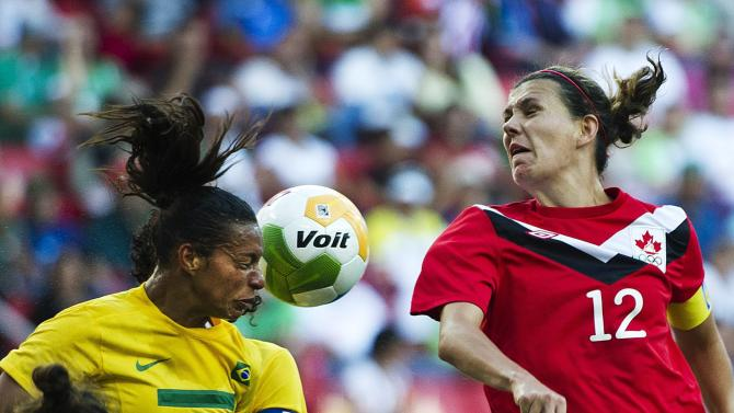 Brazil forward Rosana Augusto, left, and Canada's Christine Sinclair (12) go for a header during the women's gold medal soccer match during the 2011 Pan American Games in Guadalajara, Mexico, Thursday, Oct. 27, 2011. (AP Photo/The Canadian Press, Nathan Denette)