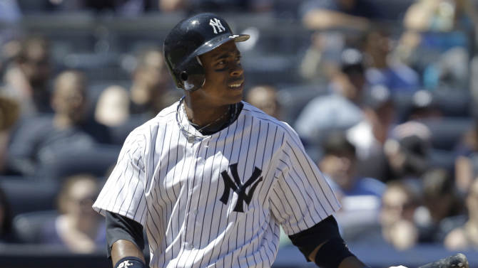 FILE - This May 20, 2012 file photo shows New York Yankees center fielder Curtis Granderson retreating to the dugout after striking out during an interleague baseball game against the Cincinnati Reds,  at Yankee Stadium in New York. (AP Photo/Kathy Willens)