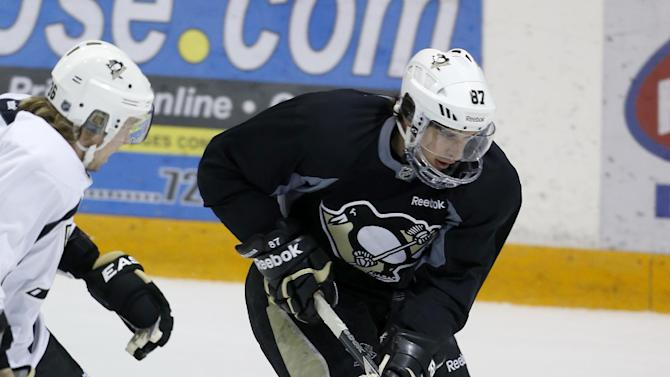 Pittsburgh Penguins Sidney Crosby, right, skates by Jussi Jokinen as they participate in an NHL hockey practice on Friday, April 26, 2013, in Canonsburg, Pa. (AP Photo/Keith Srakocic)
