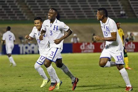 Honduras' Figueroa celebrates with teammates Costly and Najar after he scored the team's second goal against Jamaica in their 2014 World Cup qualifying soccer match in Kingston