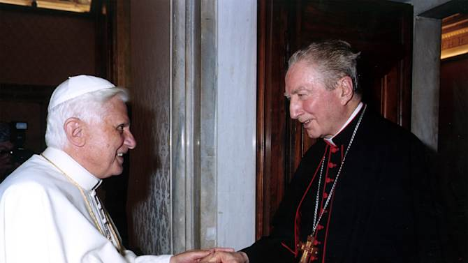 """FILE - In this May 27, 2005 file photo released by the Vatican paper L'Osservatore Romano Pope Benedict XVI greets  Cardinal Carlo Maria Martini at the Vatican. Pope have punished Jesuits theologians for being too progressive in preaching and teaching. The last pontiff, Benedict, politely but firmly sent a letter to the Jesuit's leader inviting members to pledge """"total adhesion"""" to Catholic doctrine, including on divorce, homosexuality and liberation theology. Now the pope is a Jesuit, the first ever from the missionary order's well-educated and savvy ranks in its nearly 500-year-long history, and Francis just heard the church cardinals pledge allegiance to him. Cardinal Carlo Maria Martini in a interview  published shortly after he died last year called for radical change in the Vatican, lamenting the church was 200 years behind the times. (AP Photo/L'Osservatore Romano)"""