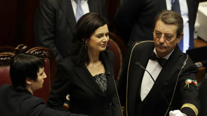 Laura Boldrini, center, acknowledges the applause of lawmakers after being elected President of the Italian lower chamber, at the end of a voting session in Rome, Saturday, March 16, 2013. (AP Photo/Gregorio Borgia)