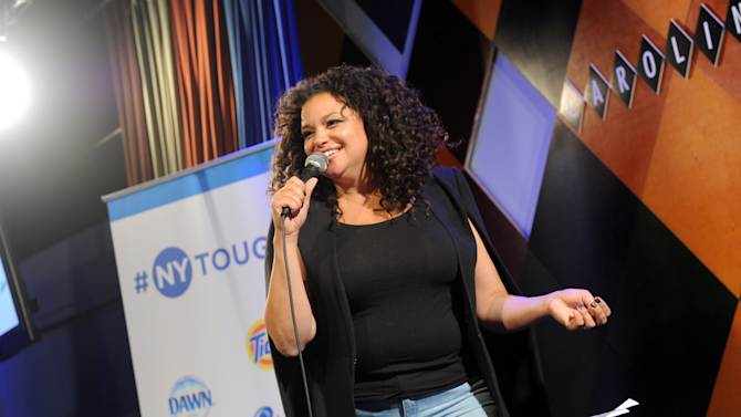 IMAGE DISTRIBUTED FOR #NYTOUGH - Comedian Michelle Buteau shares jokes about her experience living in New York at the #NYTough Comedy Showcase at Carolines on Broadway, Tuesday, Sept. 23, 2014, in New York. Share your stories using #NYTough. (Photo by Diane Bondareff/Invision for #NYTough/AP Images)
