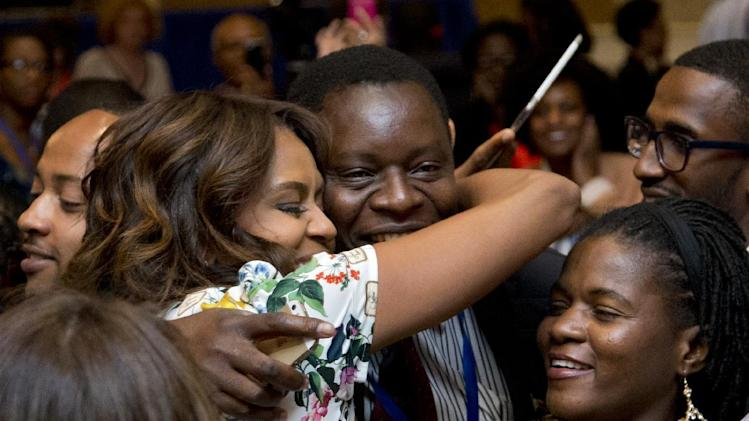 First lady Michelle Obama hugs a participant of the Presidential Summit for the Washington Fellowship for Young African Leaders in Washington, Wednesday, July 30, 2014. (AP Photo/Manuel Balce Ceneta)