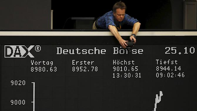 File photo of a photographer taking a picture of the German share price index DAX board