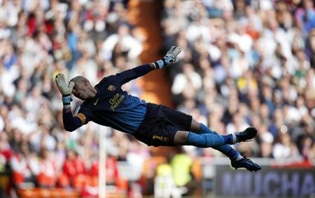 Barcelona's goalkeeper Valdes tries to make a save during their Spanish first division soccer match against Real Madrid in Madrid