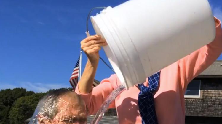In this image from video posted on Facebook, courtesy of the George W. Bush Presidential Center, former President George W. Bush participates in the ice bucket challenge with the help of his wife, Laura Bush, in Kennebunkport, Maine. The challenge has caught on with notable figures participating in the campaign to raise money for the fight against ALS, or Lou Gehrig's disease. The phenomenal success of the fundraising craze is making charitable organizations rethink how they connect with a younger generation of potential donors, specifically through social media. (AP Photo/Courtesy George W. Bush Presidential Center)