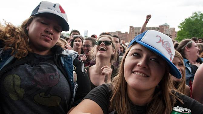 Shannon Petree, right, of Huntington West Virginia, watches the band Delta Spirit perform during the inaugural Shaky Knees Music Festival on Sunday, May 5, 2013, in Atlanta. (AP Photo/Ron Harris)