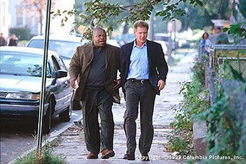 Charles S. Dutton and Harrison Ford in Random Hearts