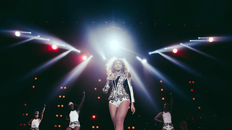 "IMAGE DISTRIBUTED FOR PARKWOOD ENTERTAINMENT - Beyonce performs onstage at her ""Mrs. Carter Show World Tour 2013,"" on Wednesday, December 18, 2013 at the Verizon Center in Washington, DC. (Photo by Robin Harper/Invision for Parkwood Entertainment/AP Images)"