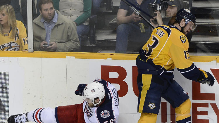Columbus Blue Jackets defenseman David Savard (58) collides with Nashville Predators forward Nick Spaling (13) in the first period of an NHL hockey game on Saturday, March 8, 2014, in Nashville, Tenn. (AP Photo/Mark Zaleski)