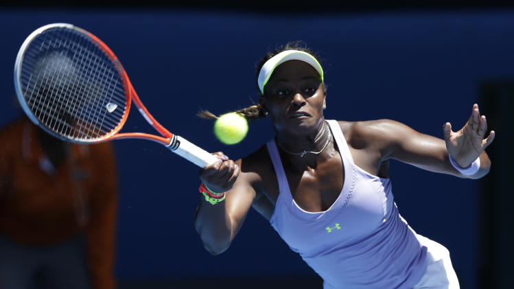 Sloane Stephens of the US hits a forehand return to compatriot Serena Williams during their quarterfinal match at the Australian Open tennis championship in Melbourne, Australia, Wednesday, Jan. 23, 2013. (AP Photo/Andy Wong)
