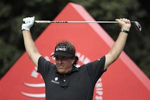 Phil Mickelson of the U.S. exercises before tees off on the 16th hole during the first round of the WGC-HSBC Champions golf tournament in Shanghai