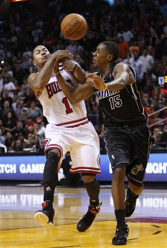 James, Heat escape with 97-93 win over Bulls