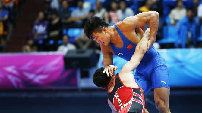 Kazakstan's Tursynov fights China's Peng in their Men's Greco-Roman 85 kg bronze medal wrestling match during the 2014 Asian Games in Incheon