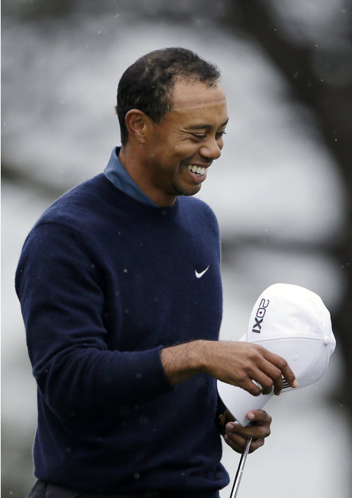 Tiger Woods smiles as he waits to hit his second shot on the seventh hole of the north course at the Torrey Pines Golf Course during the second round of the Farmers Insurance Open golf tournament Frid