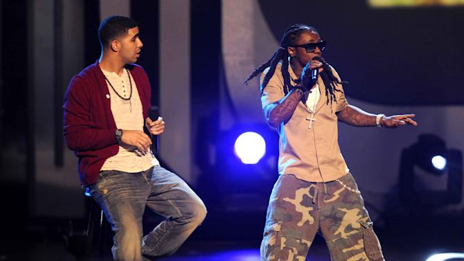 "FILE - This June 28, 2009 file photo shows Drake, left, and Lil Wayne performing at the 9th Annual BET Awards in Los Angeles. Drake, a huge Aaliyah fan, has announced that he is working on a posthumous album of Aaliyah music, and he's already released the song ""Enough Said"" featuring himself and the singer, who was killed in a plane crash in 2001.  (AP Photo/Chris Pizzello, file)"
