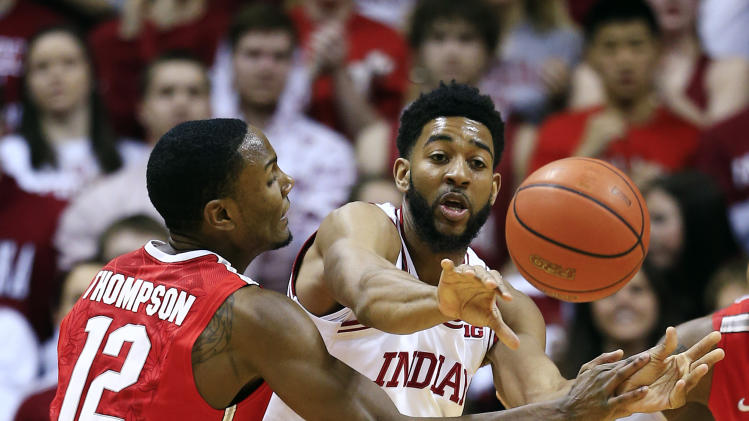 Indiana's Christian Watford, right, makes a pass against Ohio State's Sam Thompson during the first half of an NCAA college basketball game, Tuesday, March 5, 2013, in Bloomington, Ind. (AP Photo/Darron Cummings)