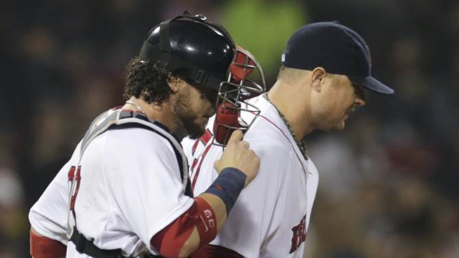 Boston Red Sox starting pitcher Jon Lester walks back to the mound with catcher Jarrod Saltalamacchia after an apparent injury while throwing during the eighth inning of a baseball game against the Toronto Blue Jays at Fenway Park, Thursday, June 27, 2013, in Boston. (AP Photo/Charles Krupa)