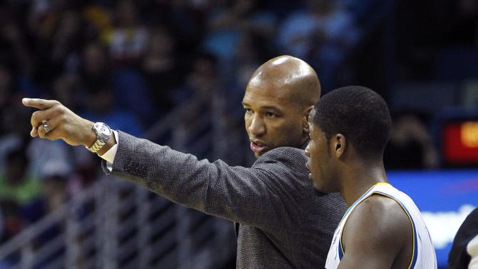 New Orleans Hornets head coach Monty Williams, left, talks with guard Jerome Dyson in the second half of an NBA basketball game against the Sacramento Kings in New Orleans, Wednesday, April 11, 2012. The Hornets won 105-96. (AP Photo/Gerald Herbert)