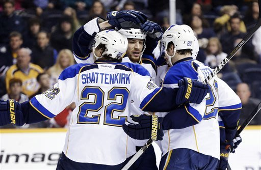 St. Louis Blues' Kevin Shattenkirk (22), Chris Stewart, center, and Alexander Steen (20) celebrate a goal against the Nashville Predators in the first period of an NHL hockey game, Monday, Jan. 21, 2013, in Nashville, Tenn. (AP Photo/Mark Humphrey)