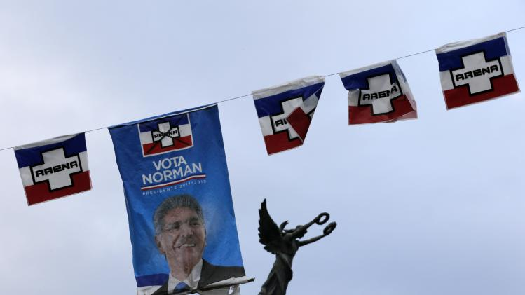 Posters of Norman Quijano, presidential candidate of the conservative Alianza Republicana Nacionalista (ARENA), are strung across light poles in downtown San Salvador