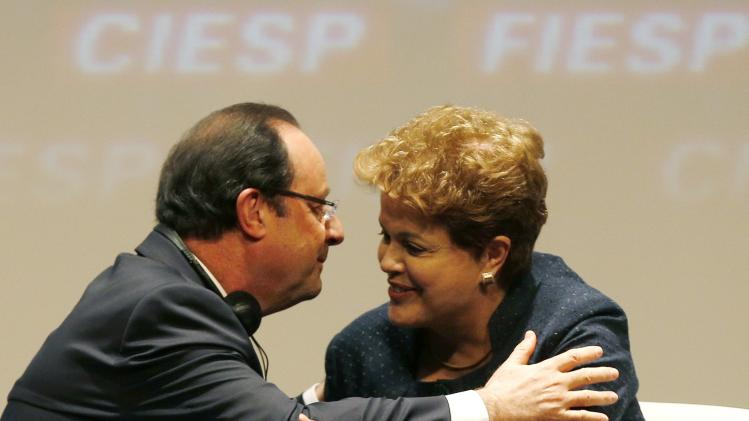 Brazil's President Rousseff greets France's President Hollande during FIESP meeting in Sao Paulo