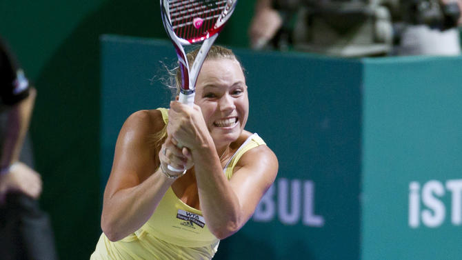 Denmark's Caroline Wozniacki returns to Poland's Agnieszka Radwanska during the WTA championship finals in Istanbul, Turkey, Tuesday, Oct. 25, 2011. Wozniacki beat Radwanska 5-7, 6-2, 6-4. (AP Photo/Vadim Ghirda)
