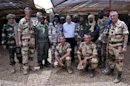 French Defence Minister Le Drian poses for a picture with French and Malian army officers at the French military base at the airport in Gao