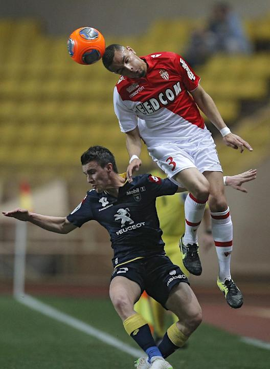 Monaco's Layvin Kurzawa of France, right, challenges for the ball with Sochaux's Sebastien Corchia of France during their French League One soccer match, in Monaco stadium, Saturday, March 8 ,