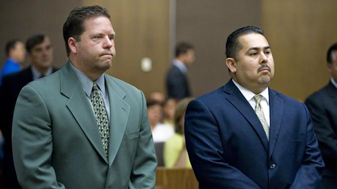 FILE - This July 13, 2012 file photo shows Fullerton police officer Jay Cicinelli, left, and former Fullerton police officer Manuel Ramos, right, appearing at Orange County Superior Court in Santa Ana. Opening statements are underway in the trial of Cicinelli and Ramos, charged in the death of Kelly Thomas, a homeless man whose family says was schizophrenic. Closing arguments are scheduled to begin Tuesday, Jan. 7, 2013. (AP Photo/The Orange County Register, Mark Rightmire, File) MAGS OUT; LOS ANGELES TIMES OUT