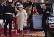 Britain's Queen Elizabeth II and Prince Philip arrive for a ceremonial welcome at Horseguards Parade for Indonesian President Susilo Bambang Yudhoyono in central London. It marks the start of a state visit aimed at impressing the emerging Asian power with pomp and pageantry