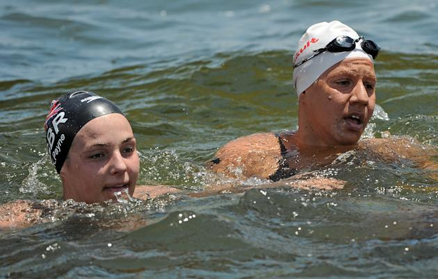 Gold medal winner Britain's Keri-Anne Payne (L) and bronze medalist Greece's Marianna Lymperta (R) look on after finishing the women's 10km open water swimming event of the FINA World Cham