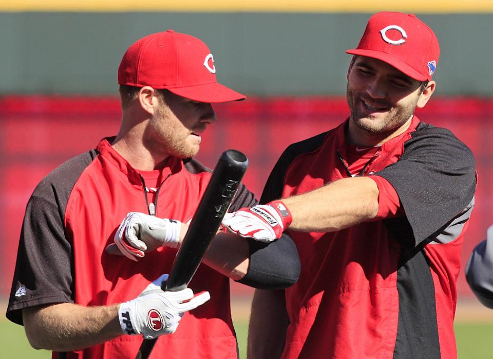 Cincinnati Reds' Joey Votto, right, jokes with Zack Cozart during batting practice prior to Game 3 of the National League division baseball series against the San Francisco Giants, Tuesday, Oct. 9, 2012, in Cincinnati. (AP Photo/Al Behrman)