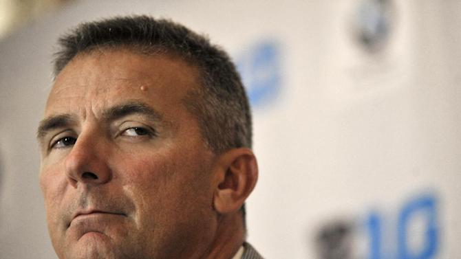 Ohio State head coach Urban Meyer talks to the media during the Big Ten Football Media Day in Chicago, Monday, July 28, 2014