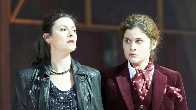 """In this photo taken Monday, May 7, 2012, Chen Reiss in the role of Servilia and Serena Malfi as Annio, from left, perform during a dress rehearsal for the opera """"La Clemenza di Tito"""" by Wolfgang Amadeus Mozart at the State Opera in Vienna, Austria. (AP Photo/Wiener Staatsoper/Michael Poehn)"""