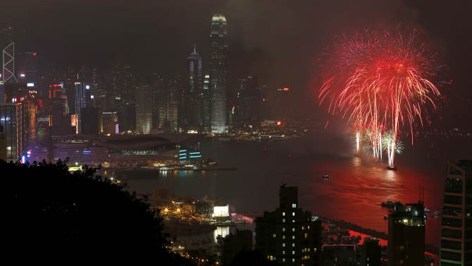Fireworks explode over the Victoria Harbour to celebrate the Chinese Lunar New Year in Hong Kong Monday, Feb. 11, 2013.  (AP Photo/Vincent Yu)