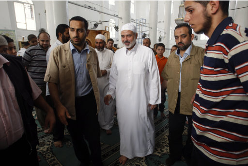 Gaza's Hamas Prime Minister Ismail Haniyeh, center, leaves a mosque after Friday prayers, in Gaza City, Friday, Sept. 23, 2011. Palestinian President Mahmoud Abbas is set to speak later Friday at the U.N., and plans to call on the world body to accept Palestine as a member. Hamas is opposed to the Palestinian Authority and has not expressed support for the statehood bid, which implies recognition of Israel. (AP Photo/Hatem Moussa)