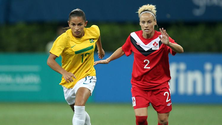 Canada's Kelly Parker, right, fights for the ball with Brazil's Debora De Oliveira during a women's soccer match at the Pan American Games in Guadalajara, Mexico, Saturday, Oct. 22, 2011. (AP Photo/Juan Karita)
