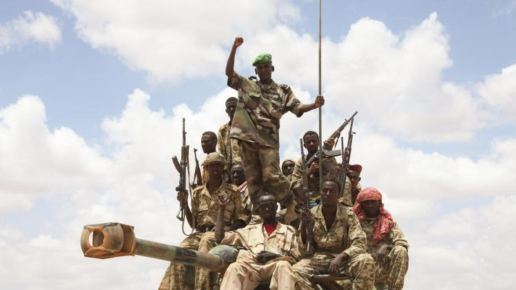 AMISOM troops, belonging to Djiboutian contingent of AU mission, celebrate after capturing al Shabaab-held town of Buule Burde