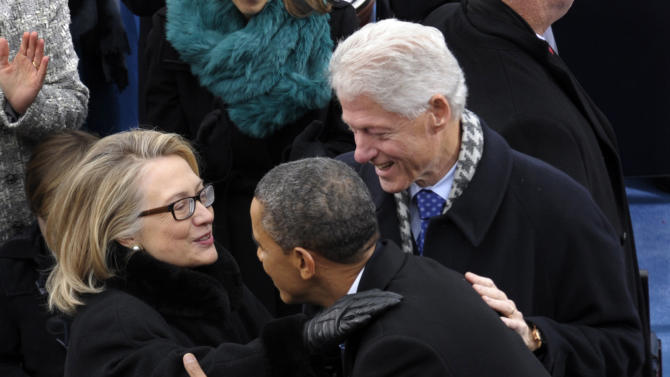 FILE - In this Jan. 21, 2013 file photo, President Barack Obama is greeted by then-Secretary of State Hillary Rodham Clinton and former President Bill Clinton for his ceremonial swearing-in on Capitol Hill in Washington, during the 57th Presidential Inauguration. The White House says President Barack Obama held a private dinner recently with the former President Bill Clinton and former Secretary of State Hillary Rodham Clinton.  (AP Photo/Susan Walsh)