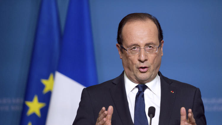 France's President Francois Hollande delivers a speech during a press conference after a general meeting at the OECD headquarters in Paris, Monday Oct. 29, 2012. (AP Photo/Bertrand Langlois, Pool)