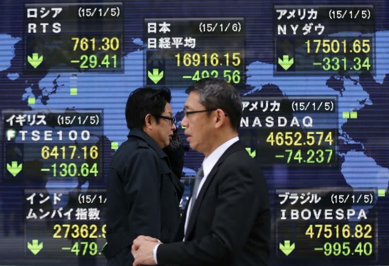 Asian shares skid as China data raises growth concerns
