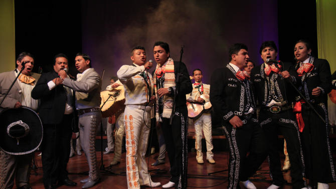 In this April 13, 2013 photo, Mariachis, representing several groups, perform together at a contest for best Mariachi group in Ecuador, in the Mexico Theater, in Quito. Mariachi music, one of the great folk genres of Mexico, has gained a strong following in the South America nation of Ecuador, and its practitioners here have come together to compete. Twelve groups initially signed up for the contest organized by the Mexican embassy in Ecuador, but in the end only seven showed up to participate after meeting the strict requirements. Each group had to have at least six members, and use at least six of the musical instruments traditionally played by mariachi bands. (AP Photo/Dolores Ochoa)
