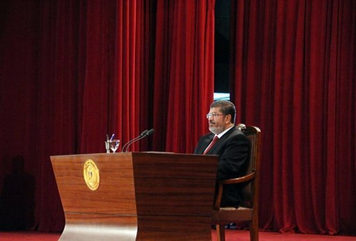 In this handout picture made available by the Egyptian Presidency, President Mohamed Morsi is pictured at Cairo's University after being sworn-in in June 2012. A decision by Egypt's new president to reinstate parliament was a bold challenge to the military that dissolved the house, but some politicians slammed it as a constitutional coup that shows no regard for the judiciary or democracy